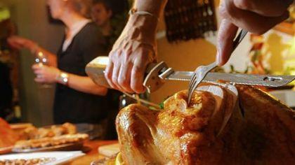 ThanksgivingSharonWeb2013 Carving the Thanksgiving turkey.