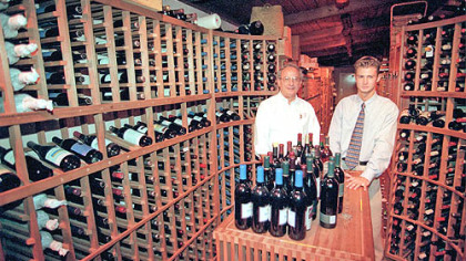 The Wooden Angel The Wooden Angel was started in 1948 by Alex Sebastian, left, and is now owned by his son, Alex Jr. They are shown in the wine cellar.
