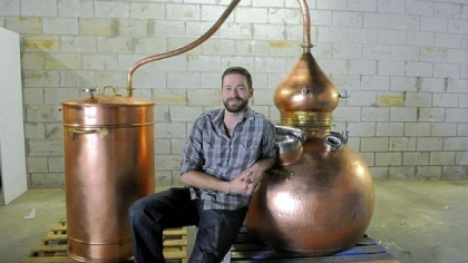 Tim Russell Tim Russell with his Spanish-made still, with which he plans to make rum and perhaps other spirits in the Strip District.