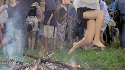 Ukrainian couple A Ukrainian couple dressed in traditional clothing jumps over a fire in a traditional Midsummer Night celebration near the capital of Kiev. This ancient pagan celebration is not part of the St. Vlad's food festival on Oct. 4 and 5 but a sumptious banquet of Ukranian food is.