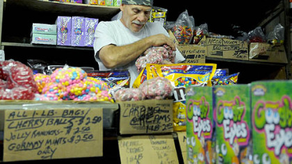 Vincent Ionadi at Fort Pitt Candy Vincent Ionadi of East Liberty, stocks the shelves at the Fort Pitt Candy Company in the Strip.