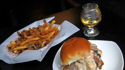 Winghart's 'Oly Cah! burger Winghart's 'Oly Cah! burger, which is topped with grilled chipped-chopped ham and beer cheese, served here with fries and a neat Aberlour A'bunadh single-malt Scotch whisky.
