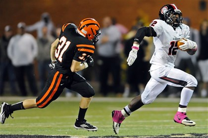 HS008-7 Aliquippa's Terry Swanson runs for a touchdown in front of Beaver Falls' Will Congdon in a game earlier this season.