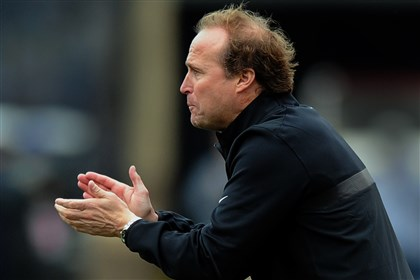 holgorsen1026 WVU coach Dana Holgorsen knows his defense needs to be ready to stop the run today against Kansas State.