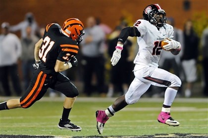 HS008-7 Aliquippa's Terry Swanson runs for a touchdown in front of Beaver Falls' Will Congdon earlier this season.