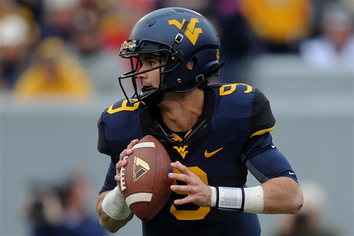 pp1018SPORTSwvufootball6-7 WVU's Clint Trickett looks to pass during the Mountaineers' home game against Texas Tech last season.