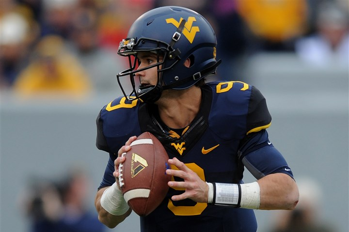 WVU's Clint Trickett WVU's Clint Trickett looks to pass during the Mountaineers game against Texas Tech in Morgantown in October.