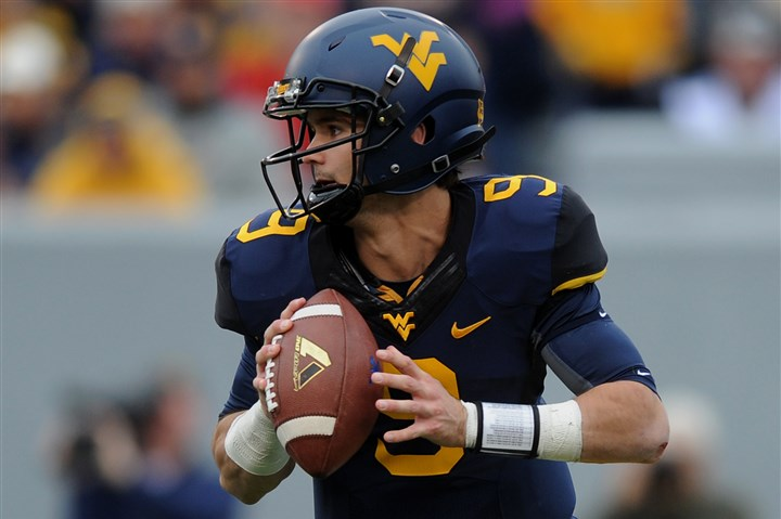 WVU quarterback Clint Trickett WVU's Clint Trickett looks to pass during a game against Texas Tech.