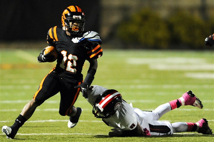 HS010-9 Beaver Falls' Kahlil Caracter gets by Aliquippa's Jyier Turner during a game earlier this season.