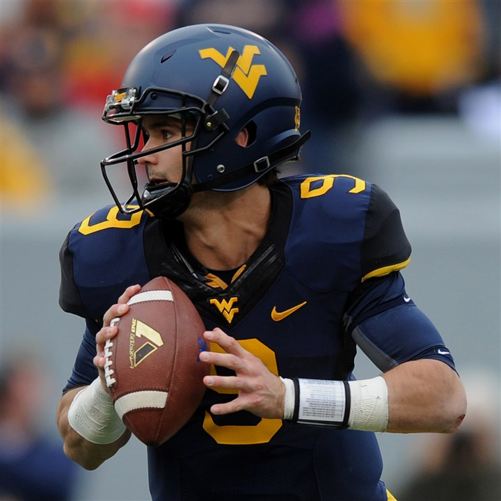 pp1018SPORTSwvufootball6-7 WVU's Clint Trickett looks to pass during their game against Texas Tech in Morgantown.