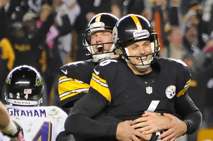 suisham1027 Steelers holder/punter Zoltan Mesko picks up kicker Shaun Suisham after Suisham kicked the winning field goal last week to beat Baltimore.