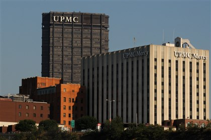 upmc2 The UPMC Mercy complex, shown against the UPMC headquarters in the U.S. Steel Tower Downtown. The region's largest health system insists it is a parent holding company that oversees 44 subsidiaries but has no employees.