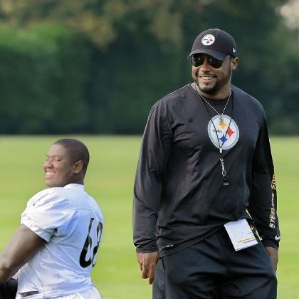 beachum1 Steelers coach Mike Tomlin shares a laugh with left tackle Kelvin Beachum in London.