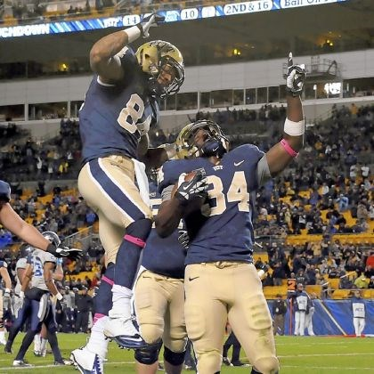 bennett1 Pitt's Isaac Bennett, right, celebrates with Ed Tinker after scoring a touchdown against Old Dominion Saturday night at Heinz Field.