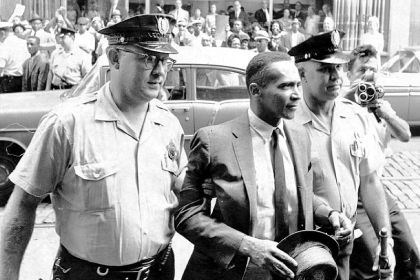 Byrd R. Brown Byrd R. Brown escorted by police officers during a 1963 protest.