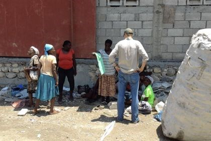 Haiti Thread Intl 1 A Thread International employee shows a Collection Center owner the fabric made from recycled plastic.