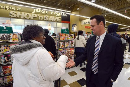 Hill shoppers Pittsburgh Mayor Luke Ravenstahl greets shopper Phyllis Bose this morning inside the long-waited grocery store in the Hill District.