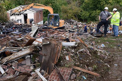Moon explosion Heavy equipment is brought in to help Allegheny County Fire Marshalls and Moon Volunteer Fire Dept. members sift through the rubble of a home at 1656 Charlton Heights Road for clues as to why the house exploded Saturday evening.