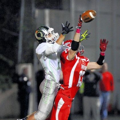 North Hills' Kevin Koch and Pine-Richland's Anthony Battaglia North Hills' Kevin Koch breaks up a pass intended for Pine-Richland's Anthony Battaglia in the second quarter Friday at North Hills.
