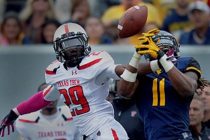 Olaoluwa Falemi and Kevin White Texas Tech's Olaoluwa Falemi breaks up a pass intended for WVU's Kevin White during their game against Texas Tech at WVU.
