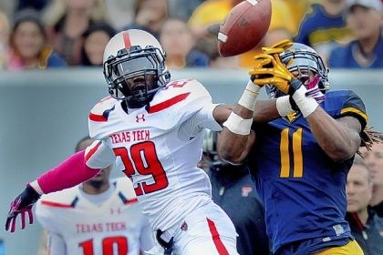 Olaoluwa Falimi Texas Tech's Olaoluwa Falimi breaks up a pass intended for West Virginia receiver Kevin White in a game earlier this season.