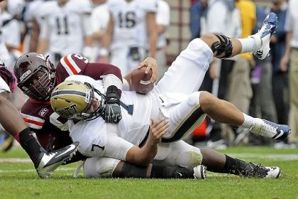 pittfb2 Pitt quarterback Tom Savage is sacked Saturday by Virginia Tech defensive tackle Derrick Hopkins. Protecting the quarterback has been an area of concern for the Panthers this season.