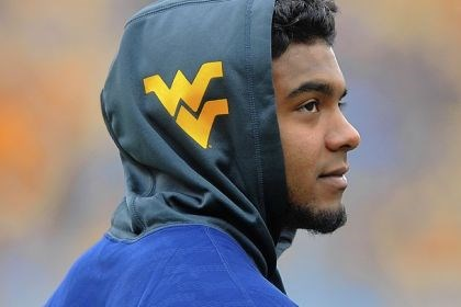 Rushell Shell Rushell Shell, who starred at Hopewell High School and played one year at the University of Pittsburgh, watches from the West Virginia University sideline Saturday at Mountaineer Field during their game against Texas Tech.