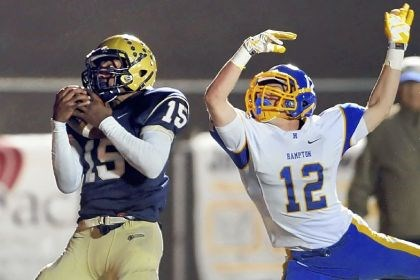 singh Franklin Regional's Charan Singh pulls in a pass for a touchdown Thursday against Hampton's Nate Hyre at Franklin Regional. Franklin Regional won, 33-12.