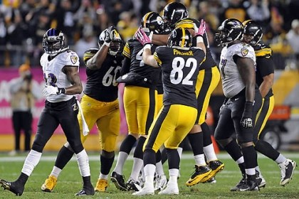 Steelers teammates celebrate Steelers teammates celebrate the winning field goal by Shaun Suisham against the Ravens Sunday at Heinz Field.