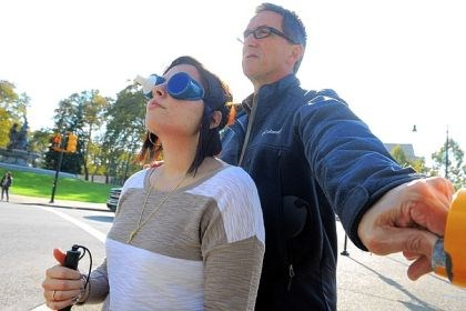 University of Pittsburgh Professor George J. Zimmerman, director of University of Pittsburgh's vision studies graduate program guides student Amanda Bellisario through mobility training Sunday at Schenley Plaza.