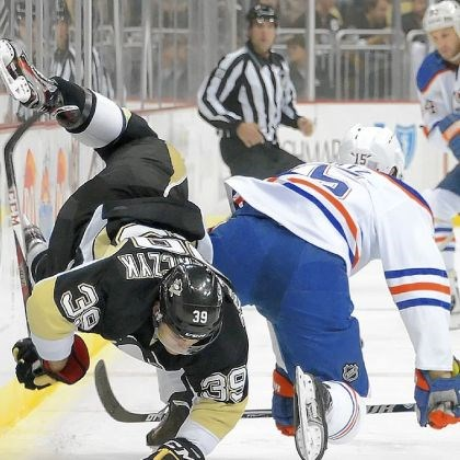 zolnierczyk Edmonton's Nick Schultz upends Penguins call-up Harry Zolnierczyk in the first period Tuesday.