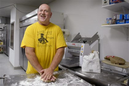 Cop Out Pierogies Police officer by day, pierogi chef by night: Carl Funtal prepares dough for pierogi Wednesday at his shop, Cop Out Pierogies in Etna.