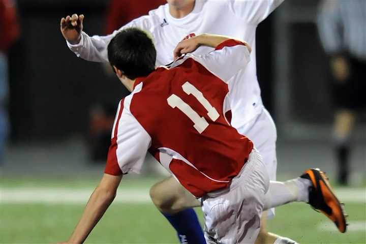 WPIAL boys soccer West Allegheny's Garrett Powell goes for the ball against Mount Pleasant's Alex Temple Monday night in a WPIAL Class AA boys soccer playoff game.