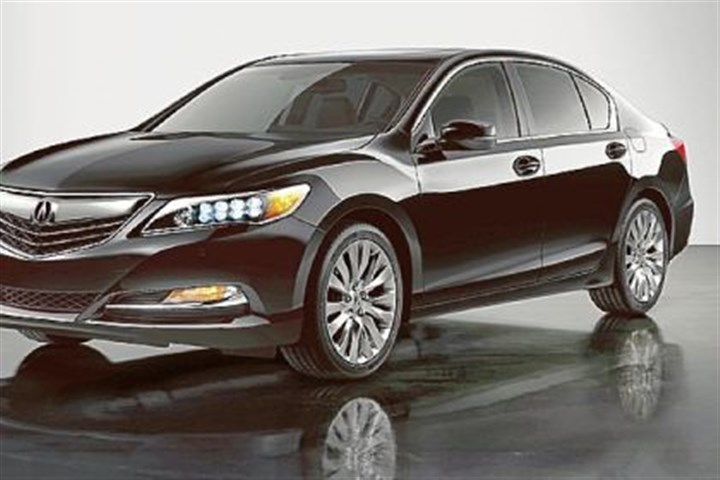 2014 Acura The 2014 Acura RLX interior is an inviting place to be. The large displays are clear and attractive, but using the lower one for changing heater and radio controls is distracting.
