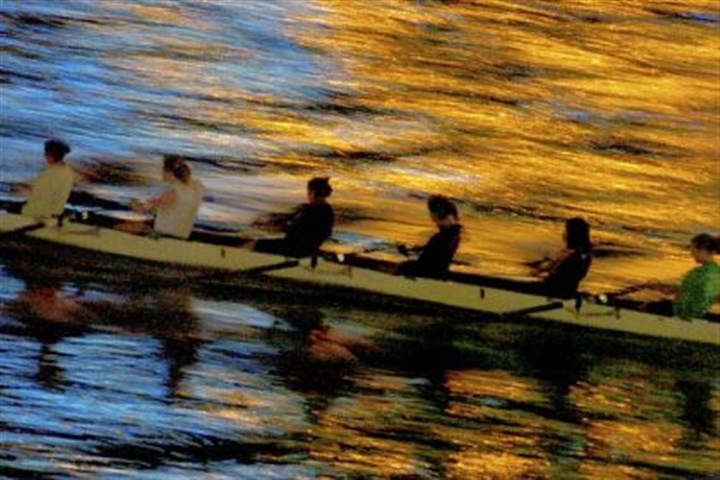 3030 livable 1 A rowing team slices through the colored waters of the Allegheny River during early morning workouts.