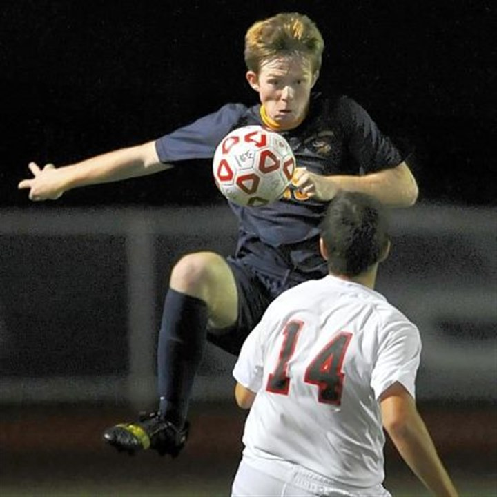 bence Central Catholic's Paul Bence works the ball against Upper St. Clair's Dom Caruso Tuesday. Upper St. Clair, ranked No. 1 in Class AAAA, defeated No. 4 Central Catholic, 4-1.