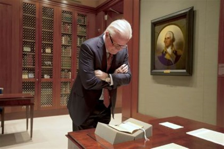 Curt Viebranz, president and CEO of George Washington's Mount Vernon Estate Curt Viebranz, president and CEO of George Washington's Mount Vernon Estate, Museum and Gardens, looks at a book that belonged to George Washington in the Rare Books Suite of the new Fred W. Smith National Library for the Study of George Washington in Mount Vernon, Va.