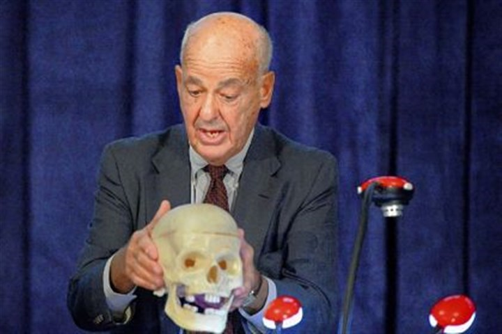 Cyril Wecht Cyril H. Wecht uses a skull to discuss the assassination of President John F. Kennedy at a symposium Thursday.