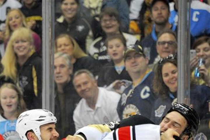glass Tanner Glass, right, mixed it up with Carolina's Jay Harrison when the teams met at Consol Energy Center Tuesday night.