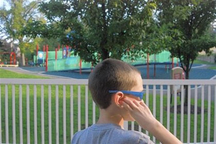 Jace Grudowski Jace Grudowski, 10, plugs his ear to muffle loud noises at The Children's Institute playground in Squirrel Hill.