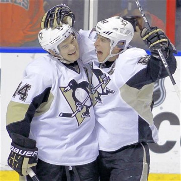 kunitz Chris Kunitz, left, and Sidney Crosby have a chemistry that Team Canada might find hard to ignore come February.