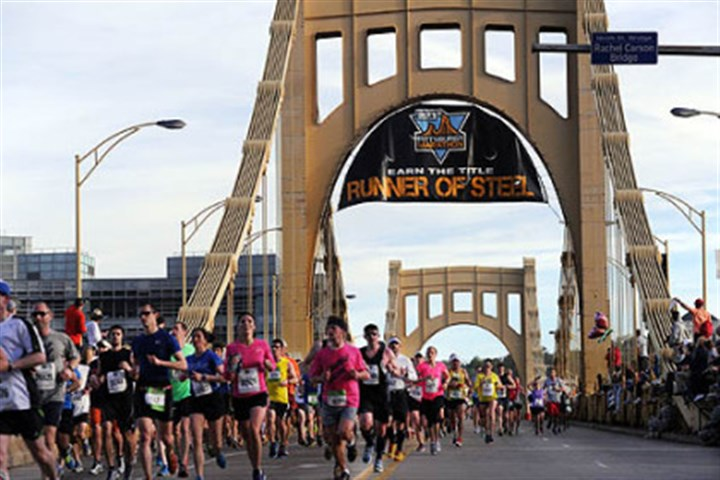 Marathon Runners cross back into the city from the North Side via the Ninth Street Bridge during this year's Pittsburgh Marathon.
