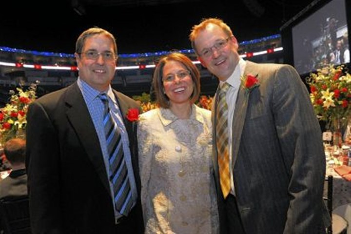 morehouse Penguins CEO Dave Morehouse poses with Nancy Angus and coach Dan Bylsma at a charity event.