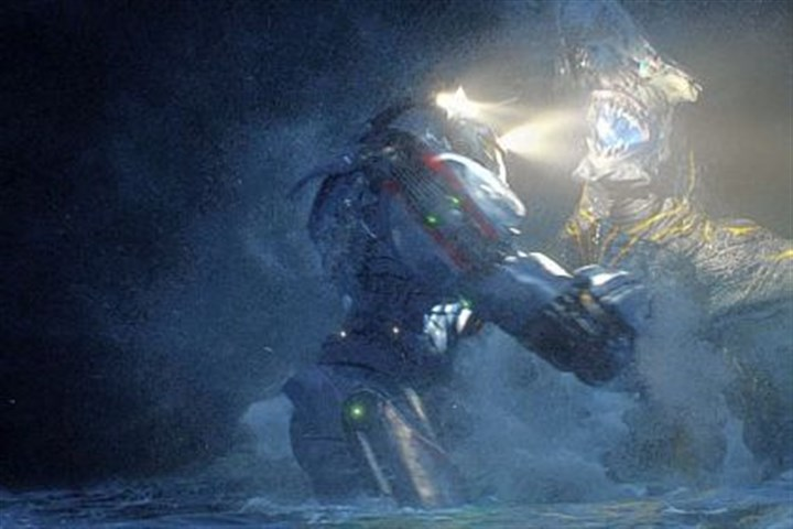 "'Pacific Rim' In ""Pacific Rim,"" 25-story robots piloted by humans wage battle against alien monsters that have risen from the sea."