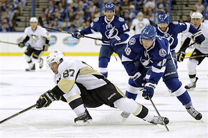 pens lightning wire 1 Sidney Crosby is tripped by Tampa Bay Lightning left wing Ondrej Palat during the first period Saturday in Tampa, Fla.