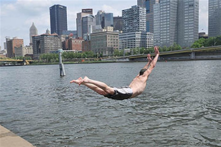 river leap Joe Russell of Imperial takes a leap off the Riverwalk into the Allegheny River.