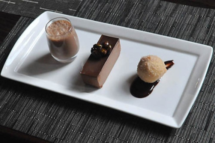 spoon chocolate Right to left, a chocolate truffle beignet, chocolate mousse and chocolate milk at Spoon in East Liberty.