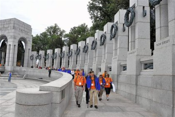 visit the World War II Memorial Members of the Honor Flight Northwest Ohio visit the World War II Memorial on Wednesday in Washington, D.C.