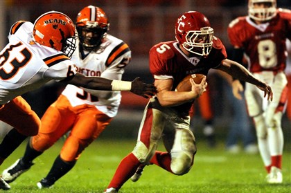 ARush_Tomlin03.1-1 Fort Cherry's Koltan Kobrys avoids a tackle by Clairton's Rashead Pacley during a game in September.