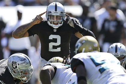 pryor1024a Oakland Raiders quarterback Terrelle Pryor signals during a game on Sept. 15.